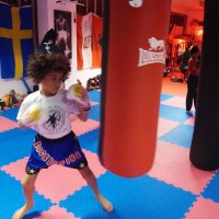 kids practice on boxing bag